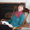 Traditional Neck Wrap relaxes stiff muscles for this woman in a rocking chair
