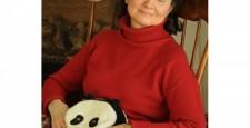 Woman relaxing with Panda Bear Warmer