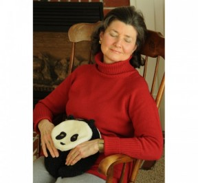 Woman relaxing with Panda Bear Warmer
