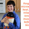 Woman holding Penguin microwave heating pad in front of a microwave oven; words say,