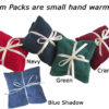 Small flannel covered hand warmers called Palm Packs in Red, Navy, Blue Shadow, Forest Green, & Cranberry