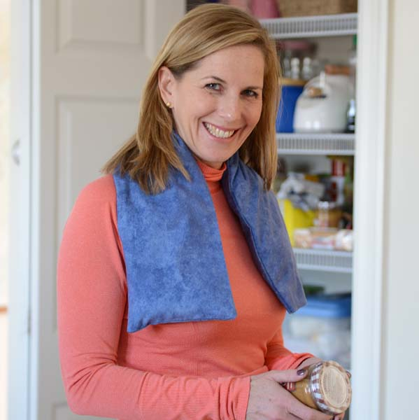 Woman Using Extra Long Neck Warmers While Preparing A Pantry Meal