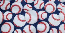 White with red stitching baseballs on royal blue background printed i=on Plush fabric