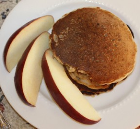 Gluten free oat pancakes with apple slices
