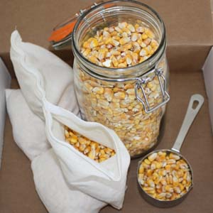 Whole corn in a Mason jar and inside a back warmer insert