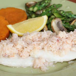 Haddock dinner with crab meat topping , sweet potatoes, and asparagus
