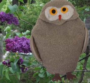 Owl microwave heating pad with lilacs in spring