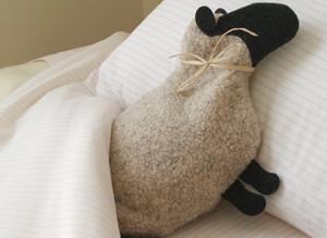 Sheep microwave heating pad warming a bed