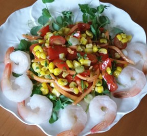 Cajun Corn Salad with Shrimp -- Gluten-free on a bed of fresh green pea shoots