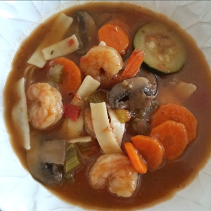 Maine Warmers shrimp & veggies with gluten-free pasta in a white bowl