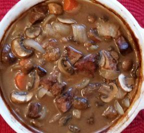 Beef Bourguignon in a white casserole dish