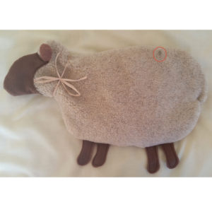 Sheep beige with brown with a small spot on the back